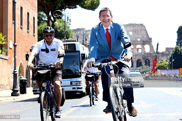 New mayor of Rome Ignazio Marino rides a bicycle in Via dei Fori Imperiali on August 3 2013 in Rome Italy The plan to ban private traffic from the...