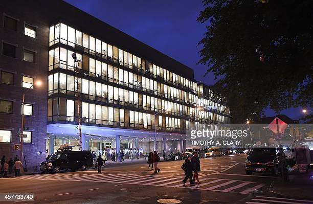 New media gather at the entrance to Bellevue Hospital October 23 2014 after a doctor who recently returned to New York from West Africa was rushed...