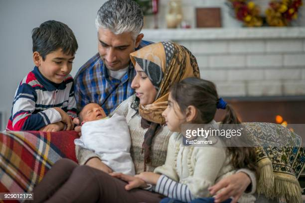 new member of the family - refugee stock photos and pictures