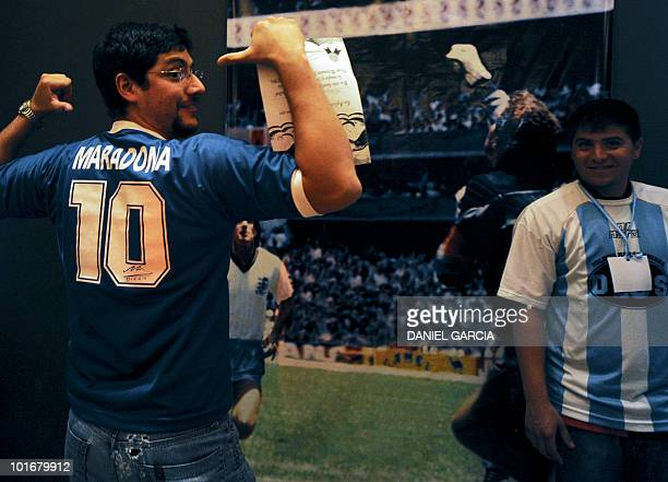 A new member of the Maradonian Church The hand of God a religion dedicated to the Argentina's greatest ever soccer player Diego Maradona celebrates...