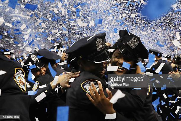 New members of the New York Police Department's graduating class celebrate in Madison Square Garden after a swearing in ceremony on July 1 2016 in...