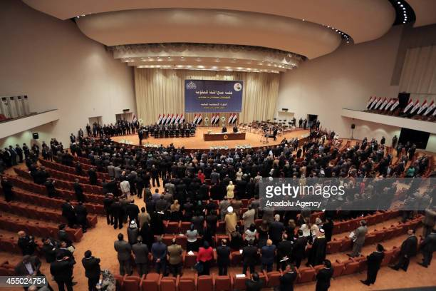 New members of the parliament attend the announcement of the new government in Baghdad Iraq on September 8 2014 A diverse participation government...