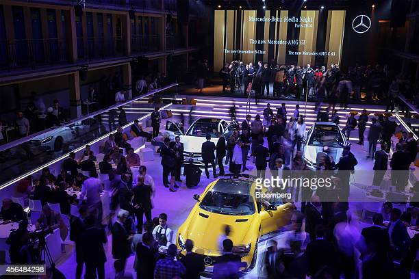 New Mercedes automobiles including the MercedesAMG GT center and MercedesAMG C63 automobiles stand on display following a presentation at the...