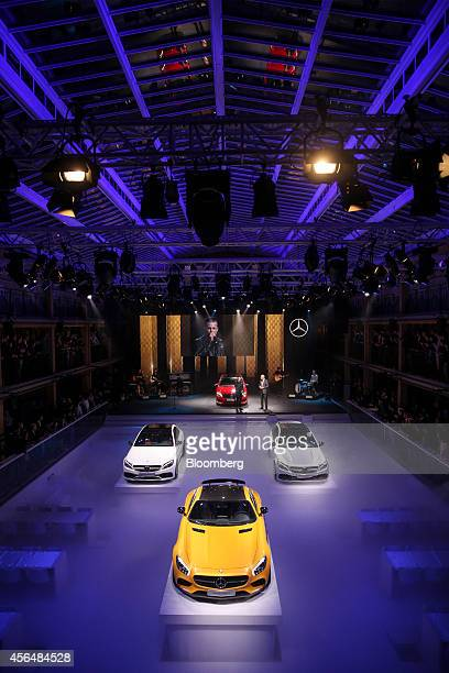 New Mercedes automobiles including the MercedesAMG GT center and MercedesAMG C63 automobiles stand on display during a presentation at the...