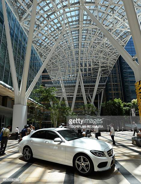 New Mercedes Benz C-class sedan is displayed at the Tokyo Mid Town shopping centre after the car was introduced as a press preview in Tokyo on July...