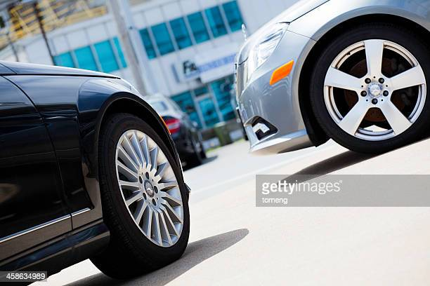 new mercedes benz vehicles at a car dealership - mercedes benz stock photos and pictures