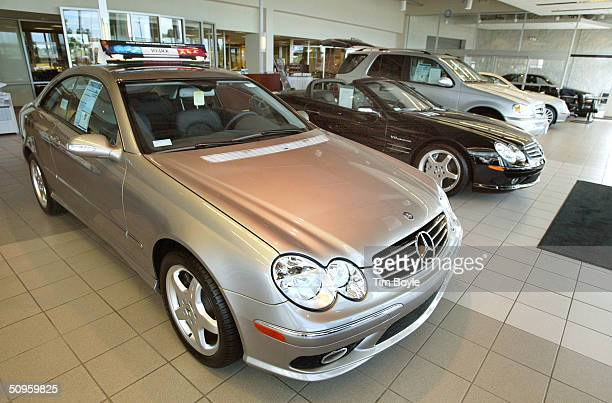 New MercedesBenz vehicles stand on display in the showroom of MercedesBenz of Hoffman Estates June 14 2004 in Hoffman Estates Illinois Although the...