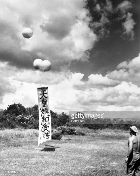 New method of informing Japs still holding out in the Sierre Madre Mountains that Hirohito had accepted unconditional surrender was tried recently by...