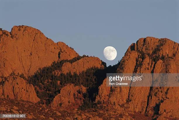 usa, new mexico, albuquerque, moon over sandia mountains - sandia mountains stock photos and pictures