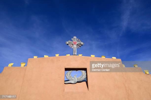 USA, New Mexico, Chimayo, Religious symbols on adobe wall