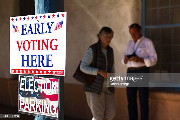 New Mexico: 'EARLY VOTING HERE' Sign, Voters in Background