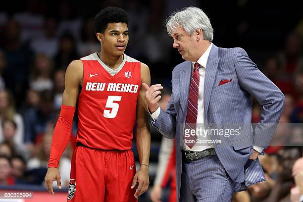 New Mexico Lobos guard Jalen Harris talks with head coach Craig Neal during the second half of the college basketball game against the Arizona...