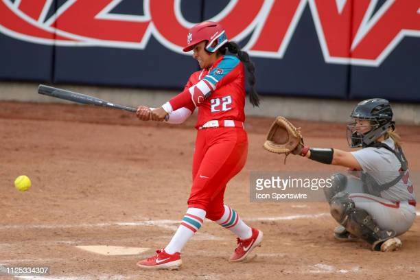 New Mexico Lobos infielder Monica Salas hits the ball during a college softball game between the Alabama Crimson Tide and the New Mexico Lobos on...