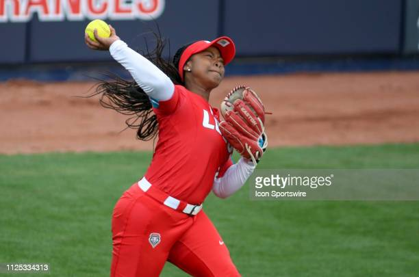 New Mexico Lobos outfielder D'Andra DeFlora throws the ball during a college softball game between the Alabama Crimson Tide and the New Mexico Lobos...