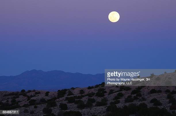new mexico moon - sandia mountains stock photos and pictures