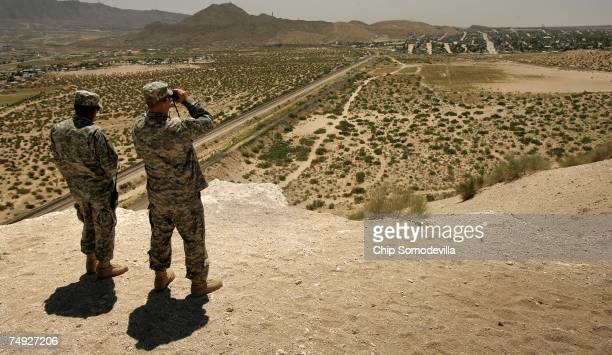 New Mexico National Guard Spec Raymond Rivera and Wyoming National Guard Spec Scott Winters spot three men near the USMexico border June 26 2007 in...