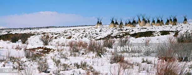 usa, new mexico, near galisteo, snow covered desert and teepees - timothy hearsum stockfoto's en -beelden