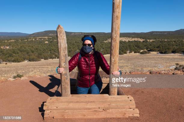 usa, new mexico, pecos, woman in face mask climbing out of storage shelter at pecos national historical park - pueblo built structure stock pictures, royalty-free photos & images