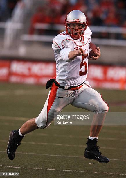 New Mexico quarterback Chris Nelson points out to his blockers as he runs against Utah at Rice-Eccles Stadium in Salt Lake City, Utah, Saturday...