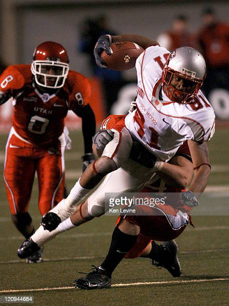 New Mexico receiver Travis Brown is tackled by Utahs Joe Jiannoni during the second quarter at Rice-Eccles Stadium in Salt Lake City, Utah, Saturday...