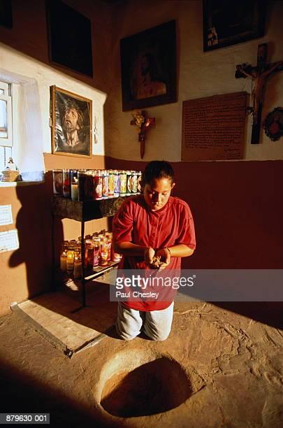 USA, New Mexico, Santuario de Chimayo, young girl (10-12) praying