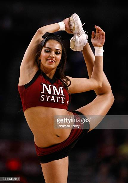 New Mexico State Aggies cheerleader performs during a break in the game against the Indiana Hoosiers in the second round of the 2012 NCAA men's...