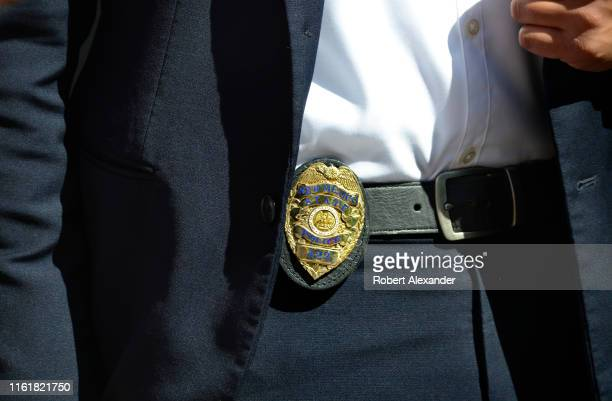 New Mexico State Police officer wearing his badge on his belt functioned as a bodyguard to Michelle Lujan Grisham the governor of New Mexico as she...