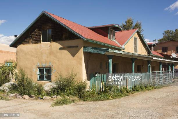 New Mexico, Taos, Ranchos de Taos, residential street scene with adobe home