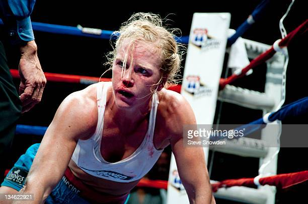New Mexico's Holly Holm gets back on her feet after French boxer Anne Sophie Mathis took her to the mat in their battle for the IBA Welterweight...