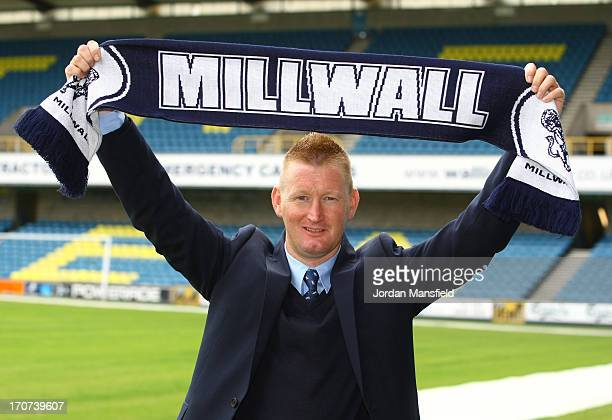 New Millwall FC manager Steve Lomas poses for a photo with a Millwall scarf after the Millwall FC Press Conference at The Den on June 17, 2013 in...