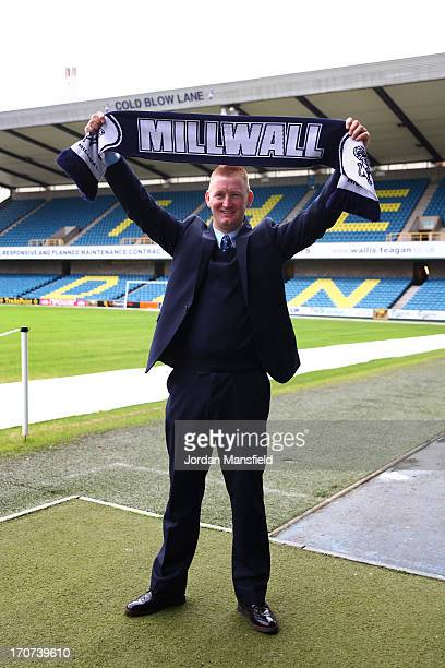 New Millwall FC manager Steve Lomas poses for a photo with a Millwall scarf after the Millwall FC Press Conference at The Den on June 17 2013 in...