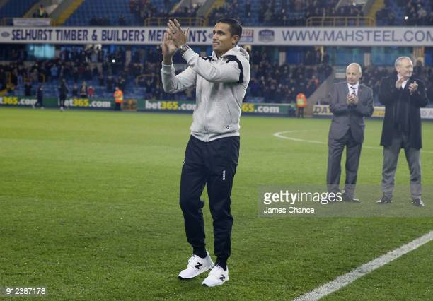 New Millwall signing Tim Cahill acknowledges the crowd prior to the Sky Bet Championship match between Millwall and Derby County at The Den on...