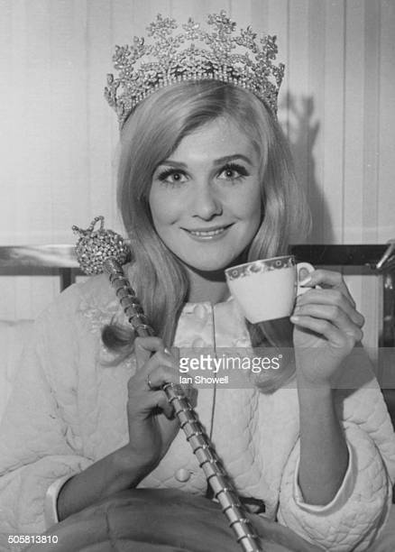 New 'Miss World' winner Penelope Plummer from Australia pictured wearing her crown and holding her scepter as she drinks tea in bed at the Waldorf...
