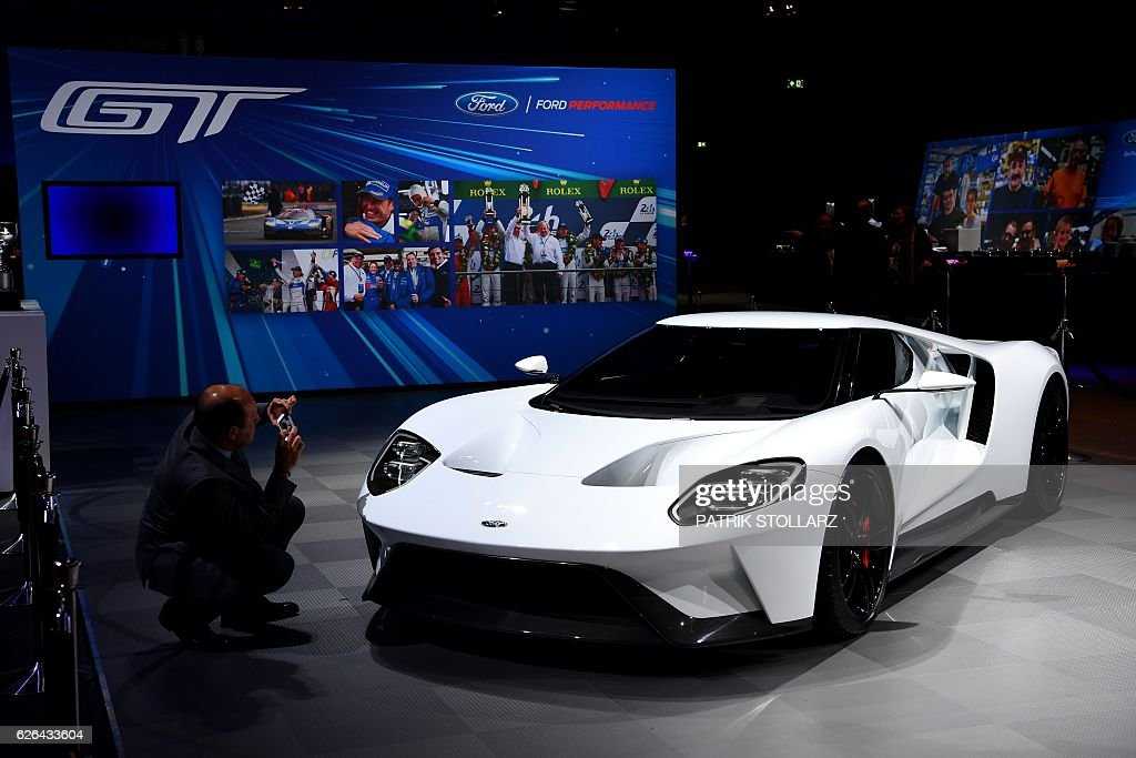 A new model Ford GT of manufacturer Ford is presented in Cologne, western Germany, on November 29, 2016. / AFP / PATRIK