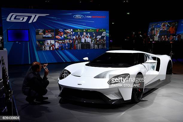 New model Ford GT of manufacturer Ford is presented in Cologne, western Germany, on November 29, 2016. / AFP / PATRIK STOLLARZ