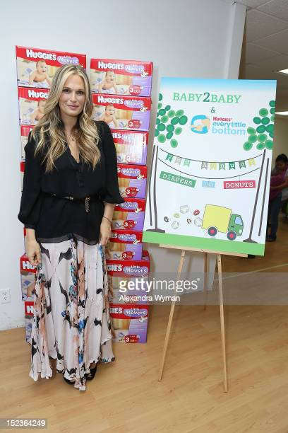 New mom Molly Sims helps pass out hundreds of thousands of diapers at the Baby2Baby and Huggies Every Little Bottom Diapers Donuts event on September...