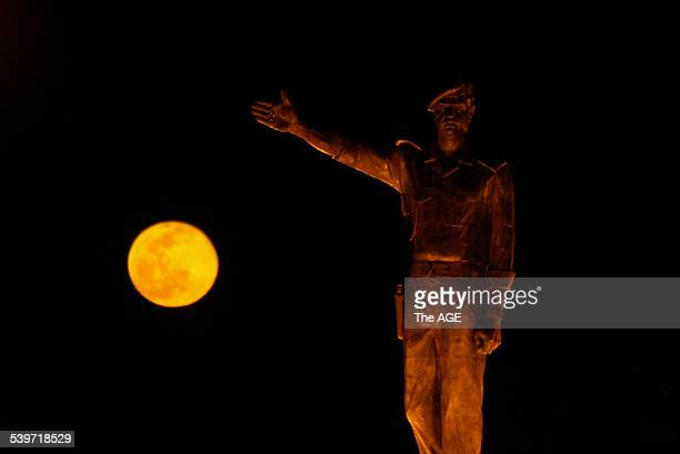 A new moon rises over a statue of Saddam Hussein in Baghdad 18 February 2003 THE AGE Picture by JASON SOUTH