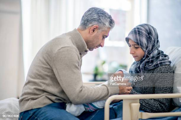 new mother and father - muslim couple stock pictures, royalty-free photos & images