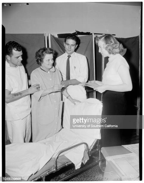 New mother votes 4 November 1952 Mrs Ruth Beckstrom 25 years Mrs Alice Stoffel Wayne Barkhouse Mrs Helen Morgan Roland Hodges Caption slip reads...