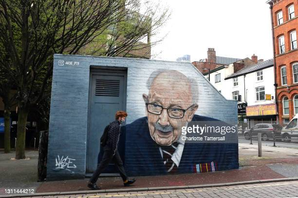New mural of British veteran and NHS fundraiser Captain Tom Moore, by artist Akse P19, is seen on a wall in Manchester's Northern Quarter on April...