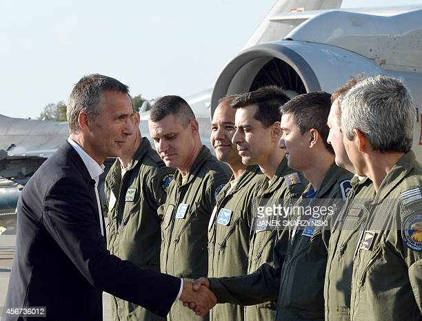 New NATO Secretary General Jens Stoltenberg shakes hands with crew members of the E3A component NATO's Flagship Fleet during his visit of the NATO...