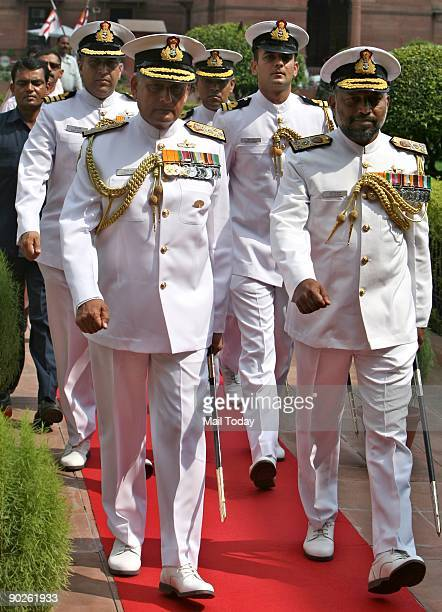 New Naval Chief Admiral Nirmal Kumar Verma arrives to inspect the guard of honour at South Block in New Delhi on Monday August 31 2009