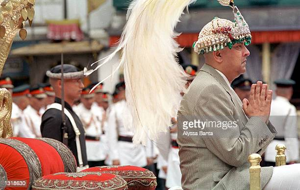 New Nepalese King Gyanendra sits on the throne reserved for coronations and wears the king''s crown during a swearingin ceremony June 4 2001 at the...