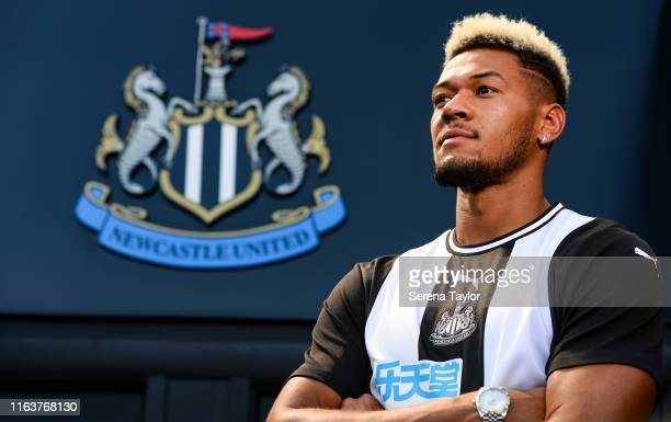 New Newcastle Signing Joelinton poses for a photo with the club crest during a photoshoot at St.James' Park on July 22, 2019 in Newcastle upon Tyne,...