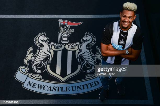New Newcastle Signing Joelinton poses for a photo with the club crest during a photoshoot at StJames' Park on July 22 2019 in Newcastle upon Tyne...