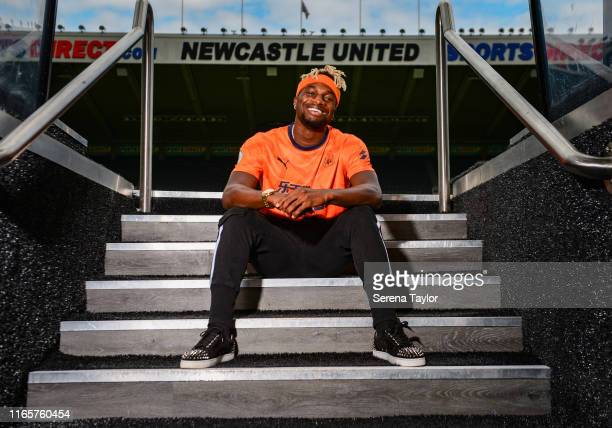 New Newcastle United signing Allan Saint-Maximin poses for photographs on the tunnel steps wearing Newcastle's Third Shirt during a photocall at...
