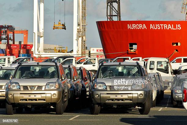 New Nissan and Toyota cars and Isuzu commercial trucks are stored and parked besides the Antarctic research ship Aurora Australis after their arrival...