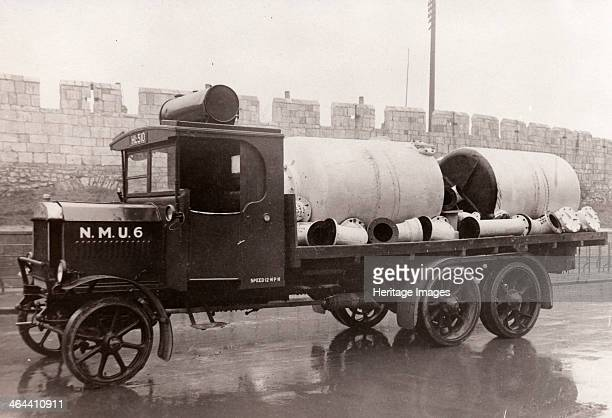A new NMU flatbacked lorry carrying pipes York Yorkshire 1918