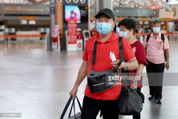 new normal: at the airport - crossbody bag stock pictures, royalty-free photos & images