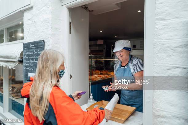 new normal bakery - customer stock pictures, royalty-free photos & images